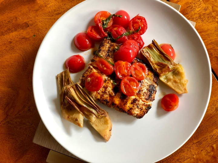 Pepper Crusted Halibut with Tomatoes and Artichokes